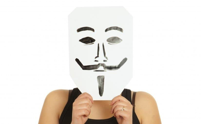 Woman with the painted Guy Fawkes mask