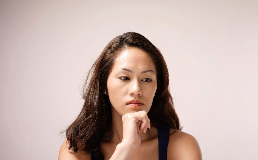 Asian chinese lady in deep thought