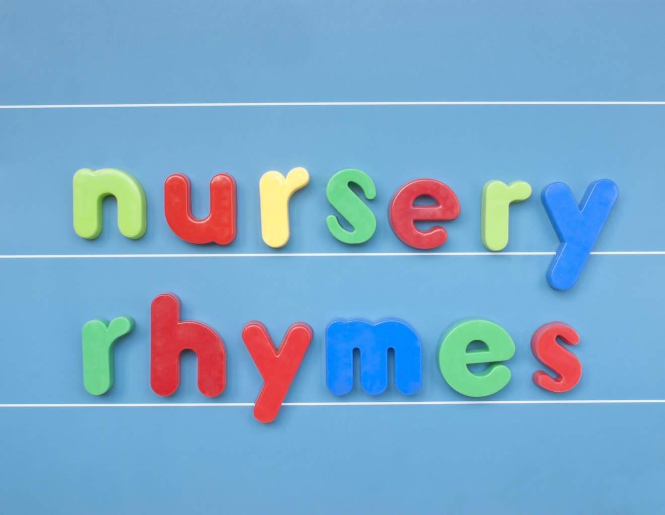 Colorful magnetic letter spelling nursery rhymes on blue board