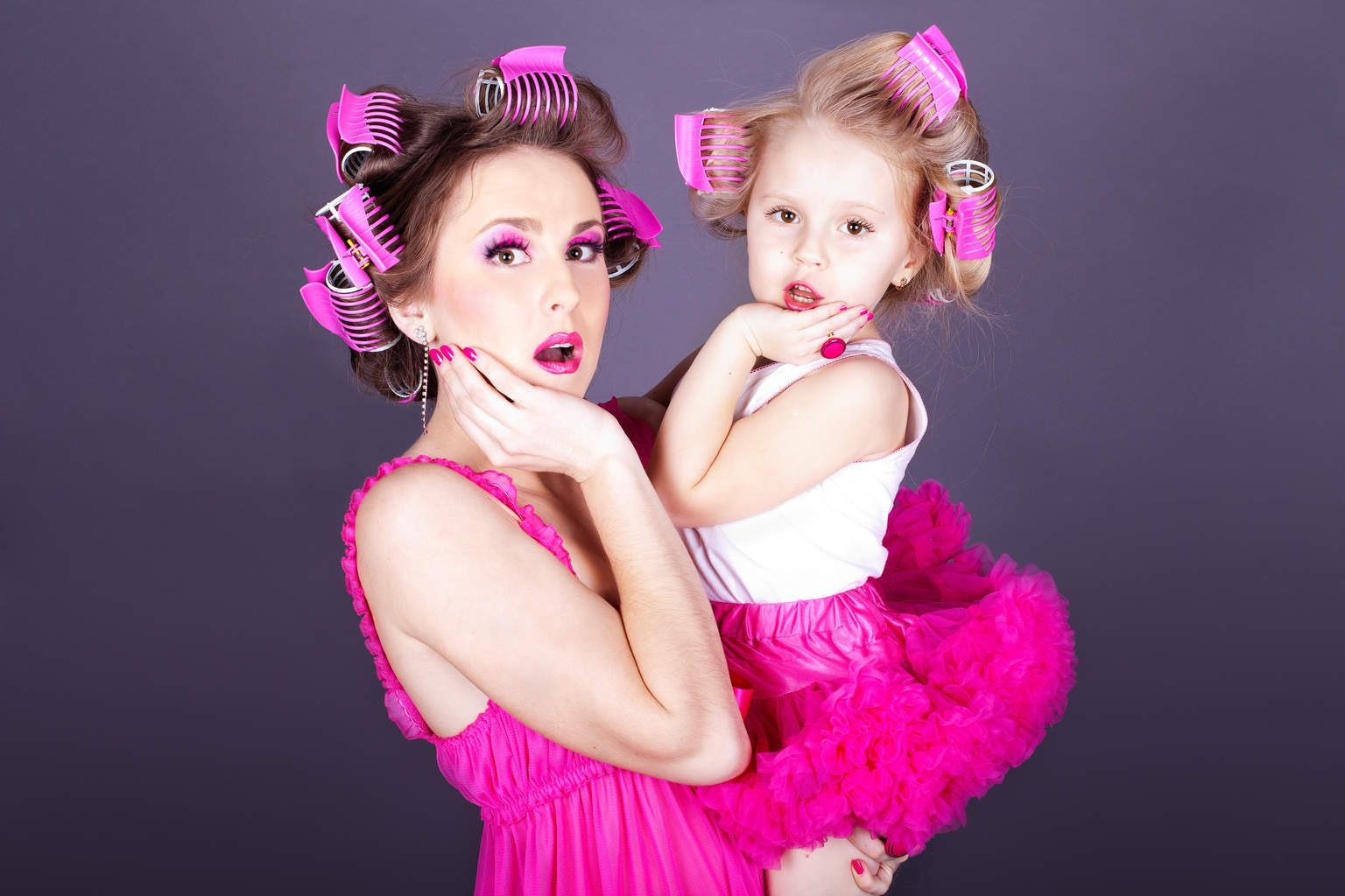 young mother with her daughter in the form of cheerful housewive