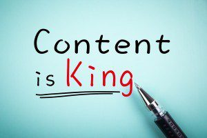 Text Content is King with underline and a ball pen aside.