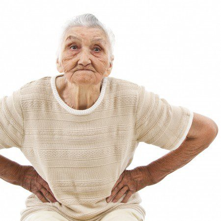 angry old woman with hands on her hips, isolated on white